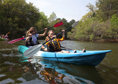 Family paddling on the Feelfree Gemini Sport sit on top kayak