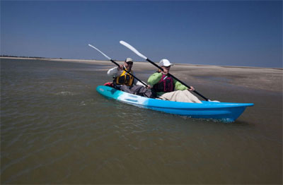 Paddling the Feelfree Gemini Sport at the beach